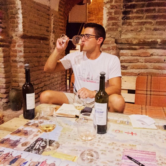 Facilitate Luxury co-founder Jacob enjoying wine at Vino Underground in Tbilisi