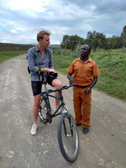 Steven on a bike in Kenya