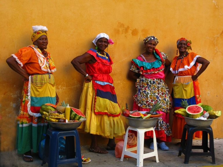 Palenqueras in their traditional, colorful dresses