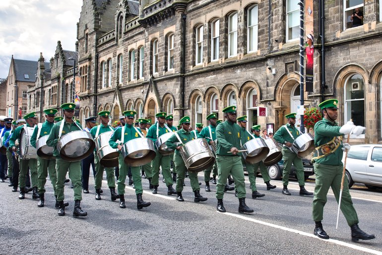 The Trinidad and Tobago Defence Force Steel Orchestra adds to the global atmosphere