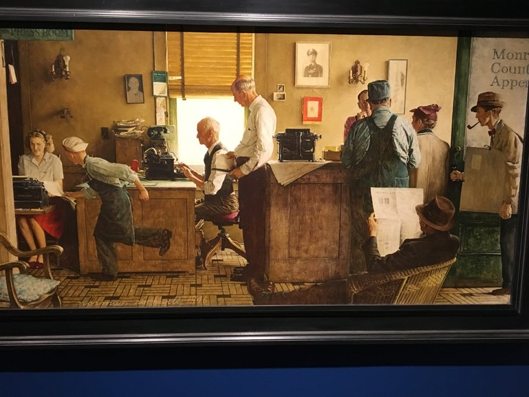 Rockwell's depiction of a 1950s-era newspaper city room