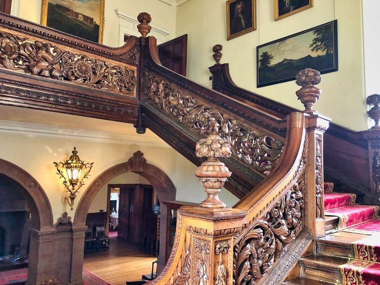 The ornate oak staircase inside Dunster Castle