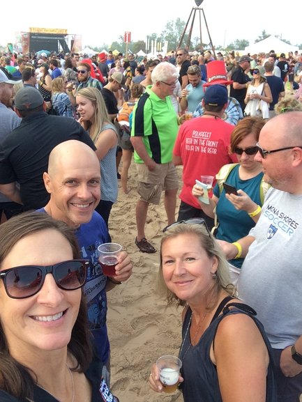A Muskegon August tradition, beer on the beach.