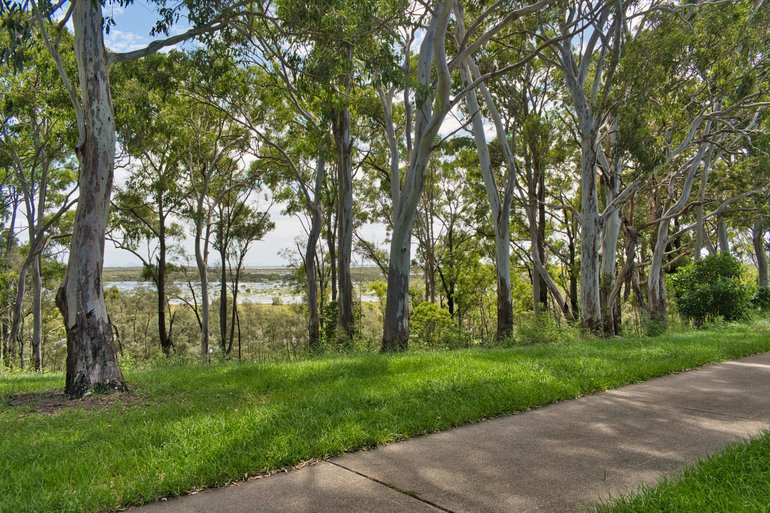 The pathway through Rothwell overlooking the wetlands and down at one of the many shelters along Deception Bay