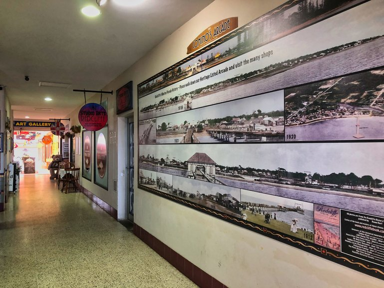 The Comino Arcade with historical photographs of early Redcliffe