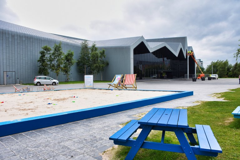 The entrance to the Riverside Museum with sandpit and picnic tables for families