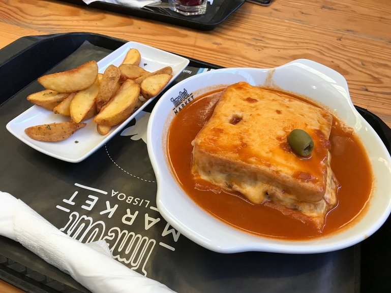 Trying a Francesinha at Time Out Market