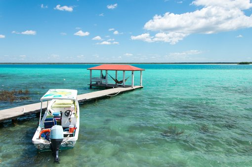 Sunrise Stand-Up Paddleboarding on Lake Bacalar:  Fifty Shades of Blue