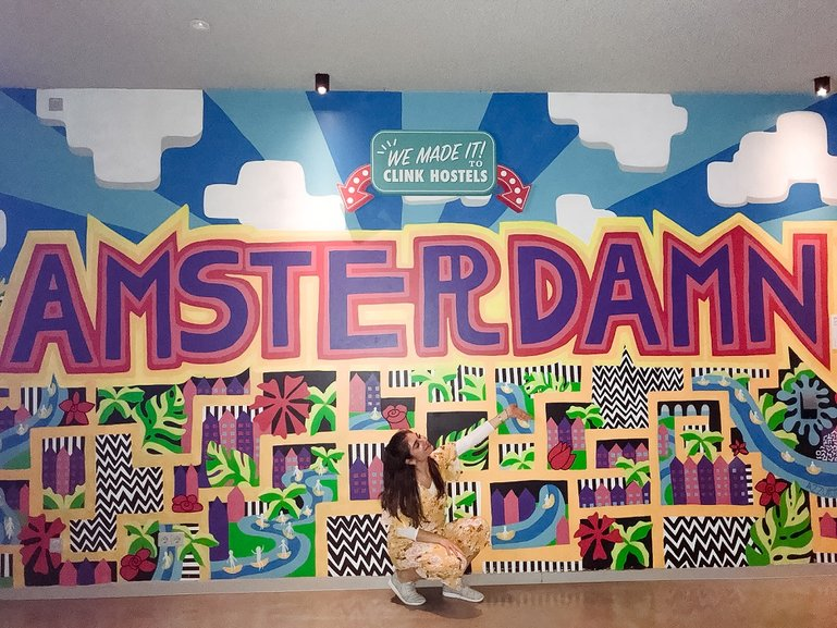 In front of a fun artsy wall at my hostel, ClinkNOORD, in Amsterdam!