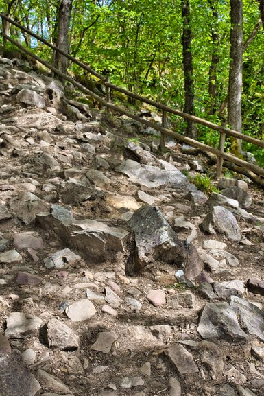 The smooth path gives way to a rocky scramble down