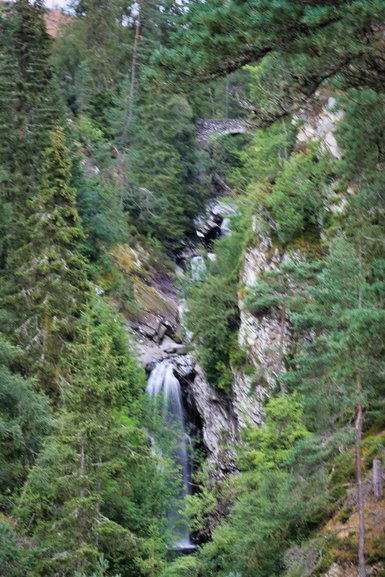 The view from partway up the path to Upper Falls. The bridge is at the top of the photo.