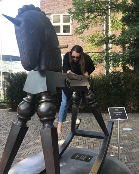 Here is a picture of me struggling to climb onto a Banksy sculpture!