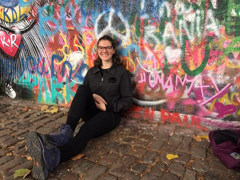 Cheery in front of the Lennon Wall in Prague