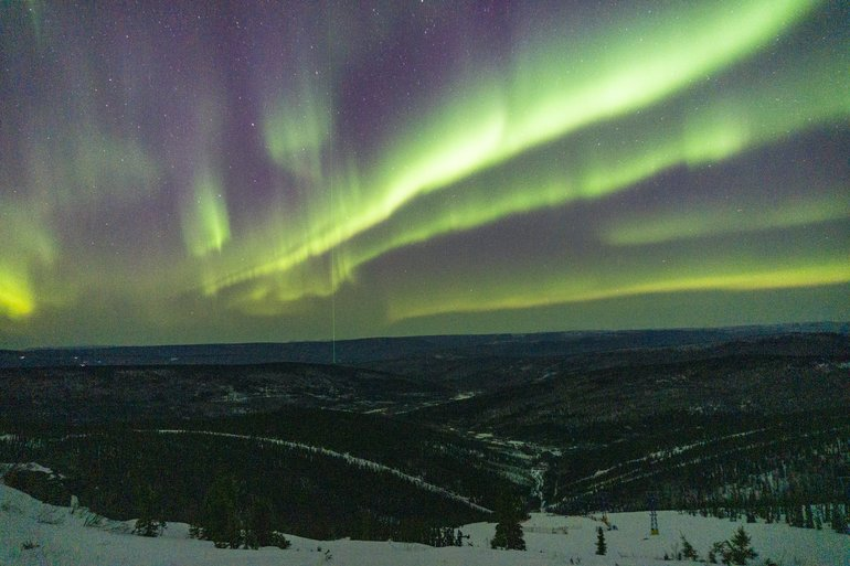 Aurora in all her glory dancing above Poker Flats as viewed from Skiland Lodge